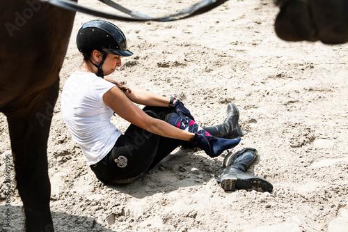 Horse riding. Rider injury while riding a horse. Tablou Canvas