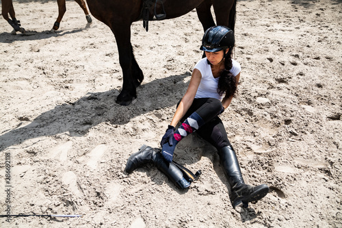 Horse riding. Rider injury while riding a horse. Fototapet