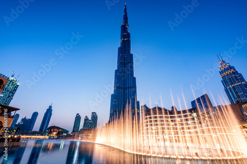 Canvas Print Fountains in Dubai mall overlooking Dubai cityscape and buildings