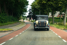 Classic Wedding Car Driving On...