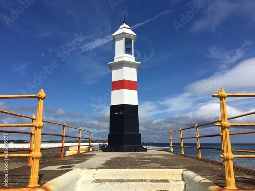 Lighthouse situated on the breakwater at Ramsey Harbour in the Isle of Man Canvas Print