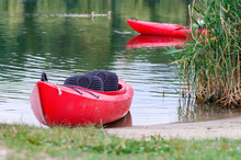 Red Kayak By The Shore Of A River. Selective Focus.