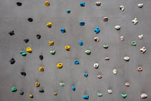 Wall With Climbing Holds In Gym