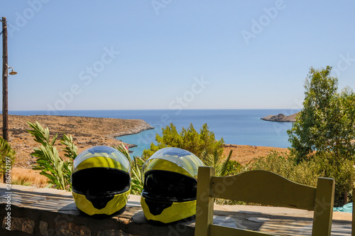 Photo  motorcycle helmets on a seascape