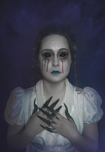 Pale Skin Woman In Gothic Styl...