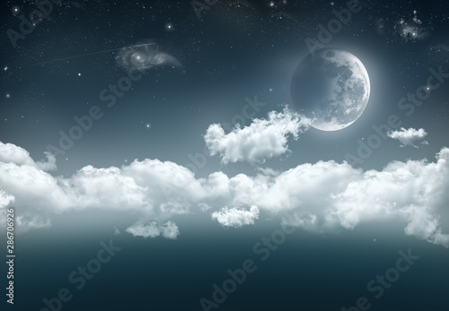 Valokuva An illustration of a cresent moon on the right with a long band of cloud, stars, shooting star and galaxies against the dark blue of space