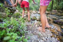 Children Adventure At Forest Creek In Nature