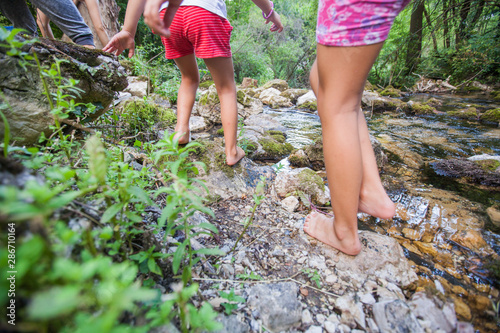 Fotografia Children adventure at forest creek in nature
