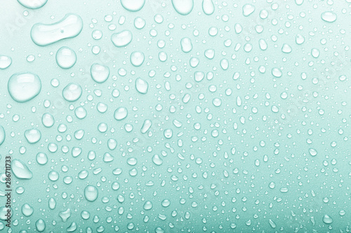 Fotografia Drops of water on a color background