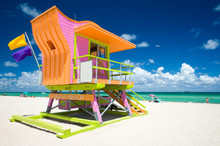 Vibrant Sunny View Lifeguard Tower Painted Bright Colors Under Blue Sky On South Beach, Miami, Florida