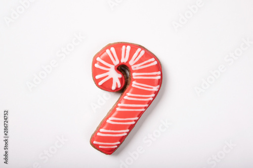 Christmas cookie in shape of candy cane on white background Canvas Print