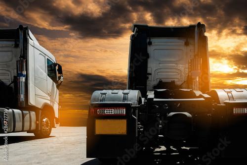 Obraz na plátně  truck transportation, semi truck parking at sunset