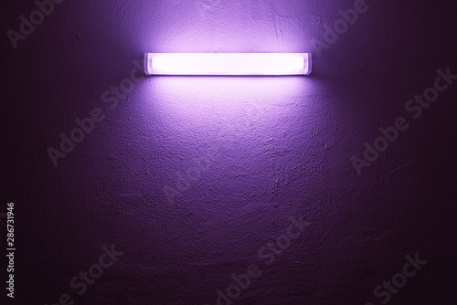 Obraz UV lamp on a rough wall. - fototapety do salonu