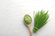 Spoon Of Wheat Grass Powder An...