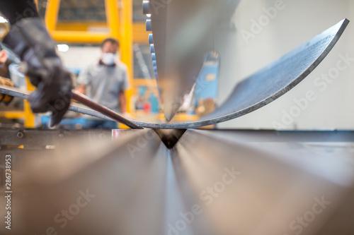 Fotografía Asian worker in factory at metal workshop - bender