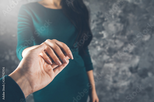 lovely woman and man hands on abstract background