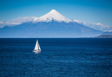 Modern Sailboat Sails In Front...