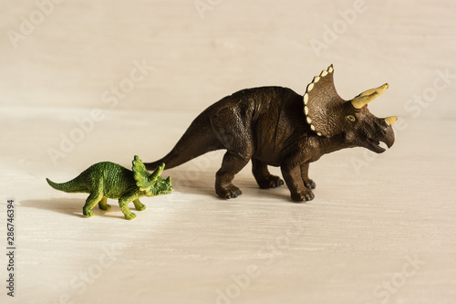 horned triceratops with cub. plastic dinosaur figures of extinct ancient creatures and  favorite toys of kids