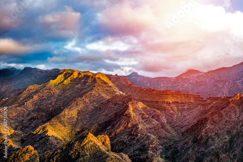 Foto auf Gartenposter Rosa hell Road in the mountains with the beautiful sunset view.