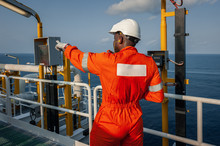 Employee In Uniform On Board O...