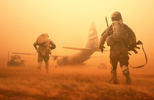Military Troops And Helicopter On The Way To The Battlefield / Between Sand Storm In Desert