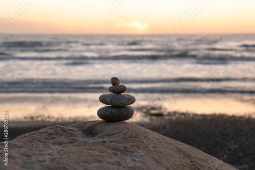 Photo sur Plexiglas Zen pierres a sable Stack Stones At Sunset