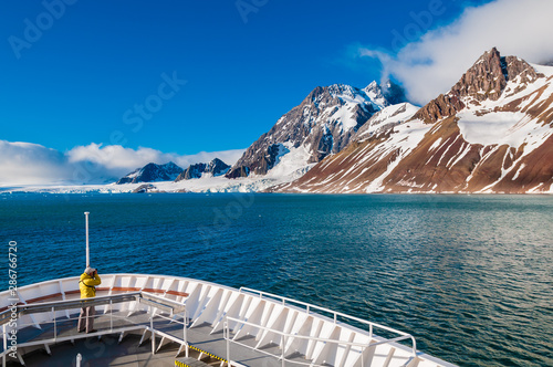 Photographer on the bow of a cruise ship in Svalbard, Norway.