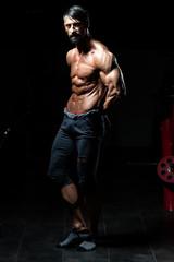 Fototapeta na wymiar Portrait Of A Man In Modern Gym