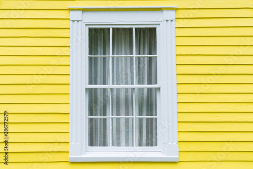 Old Window with Yellow Siding