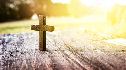 Fototapeta  Wooden cross on background . Closeup of wooden Christian cross