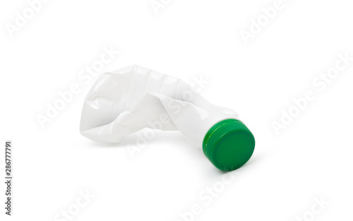 Simple deformed plastic bottle isolated on a white Canvas Print