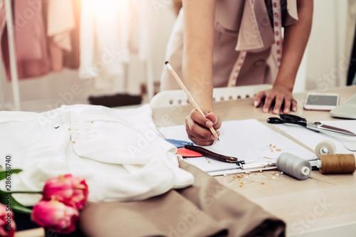 Fotografija Closeup of attractive female fashion designer hand working in home office workshop