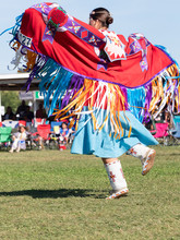 Young Native American Woman Dancing With Shawl Over Outstretched Arms
