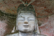 Statue Of Buddhahood Or Enlightenment Of Liu Benzhun At Dazu Rock Carvings At Mount Baoding Or Baodingshan In Dazu, Chongqing, China. Small Relief On The Head In Niche Is Himself Of Being Layman.
