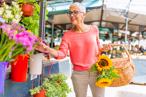 Attractive Mature Woman Shopping In An Outdoors Fresh