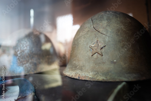 Fotografie, Obraz World War II, Old Military Helmet With Star Symbol, The scene combat helmet in World War 2
