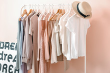 Rack With Clothes Near Color W...