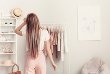 Young Woman Choosing Clothes I...