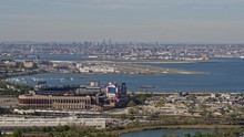 NYC New York Aerial V155 Low Panning Cityscape Views Of Bronx, LGA Airport, And Manhattan Cityscape With Flushing Meadows In Foreground - October 2017