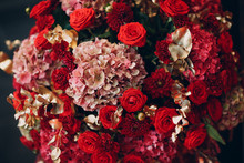 Wedding Decor With Vase And Red Flowers Roses