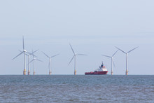 Offshore Wind Farm Turbines With Maintenance Supply Vessel Ship