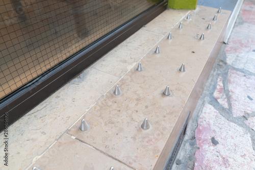 Fototapeta  Anti-homeless spikes hostile architecture defensively designed street furniture
