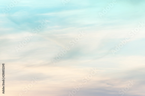 Foto auf AluDibond Licht blau sunset background. sky with soft and blur pastel colored clouds. gradient cloud on the beach resort. nature. sunrise. peaceful morning. Instagram toned style
