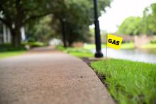 Gas Line Stake Flag Buried Underground Utility Beside A Footpath