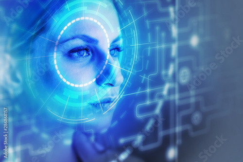 Fotografiet  Woman face and facial recognition interface