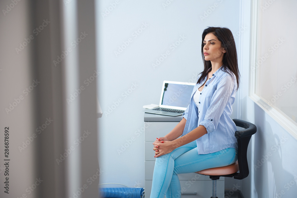 Fototapeta Pretty young woman sitting in dental room