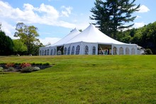 Large White Wedding Or Events Tent At The Top Of A Hill