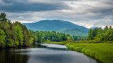 Fototapeta Nowy Jork - Looking south over the Ausable River on a cloudy day towards the Sentinel Mountain Range in Wilmington, the Adirondacks, New York