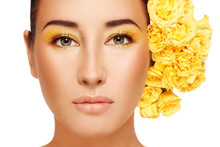 Portrait Of Young Beautiful Woman With Fancy Makeup And Yellow Roses In Hair