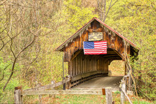 A Covered Bridge, Long Abandoned, Still Stands In The Countryside Despite Being Neglected With Weathered Wood.